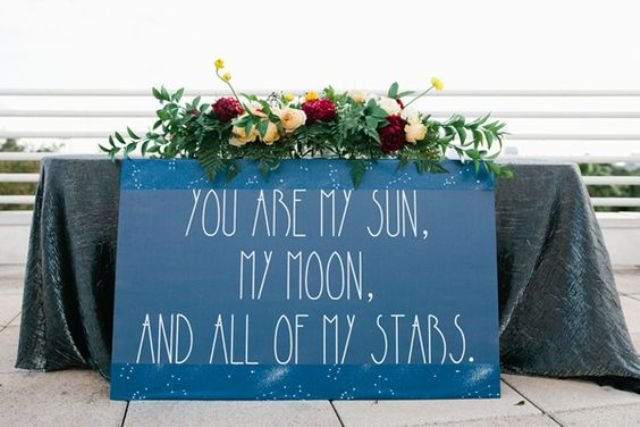 a large romantic sign that marks the sweetheart table at your celestial or astronomy wedding