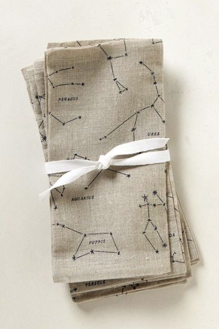 neutral constellation napkins with a white ribbon is a cool and edgy idea for a galaxy or astronomy wedding