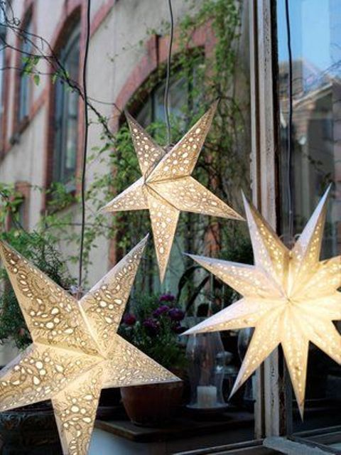 hang some lit up stars as lamps and lights to make your reception or ceremony space cozier and cooler