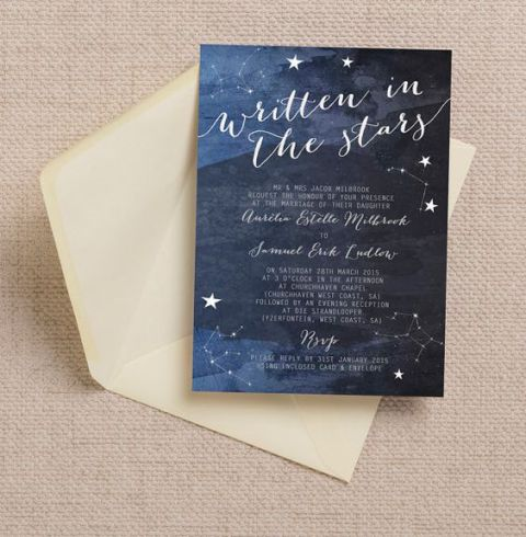 a navy wedding invitation with stars and a neutral envelope is a stylish idea for a celestial wedding