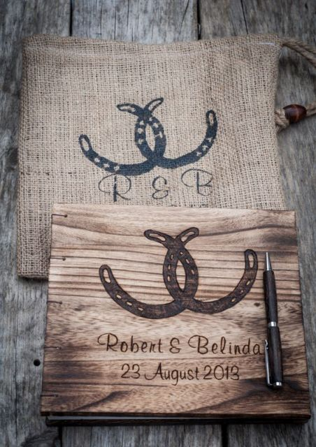 a wooden box for wedding cards with horseshoes and a matching burlap bag to put it inside