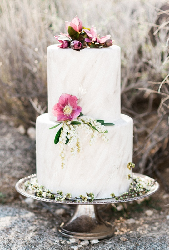 a neutral marble wedding cake with pink blooms and lily of the vally for a tender and cool spring wedding