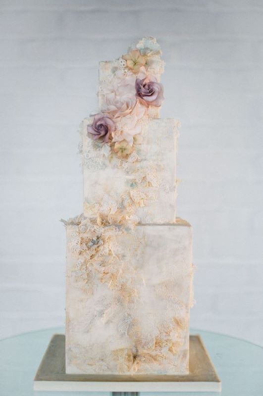 a refined neutral marble wedding cake with sugar blooms and patterns is an ethereal and out of the box solution to rock