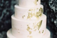 a light pink watercolor wedding cake decorated with gold leaf is a chic idea for a spring or summer wedding