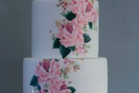 a white wedding cake accented with gold leaf and handpainted with bright blooms is a chic idea for summer