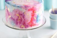 a bright watercolor wedding cake accented with gold leaf is a bold and cool idea for a modern colorful wedding