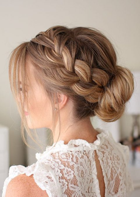 a French braid low bun with some locks down looks voluminous and very romantic