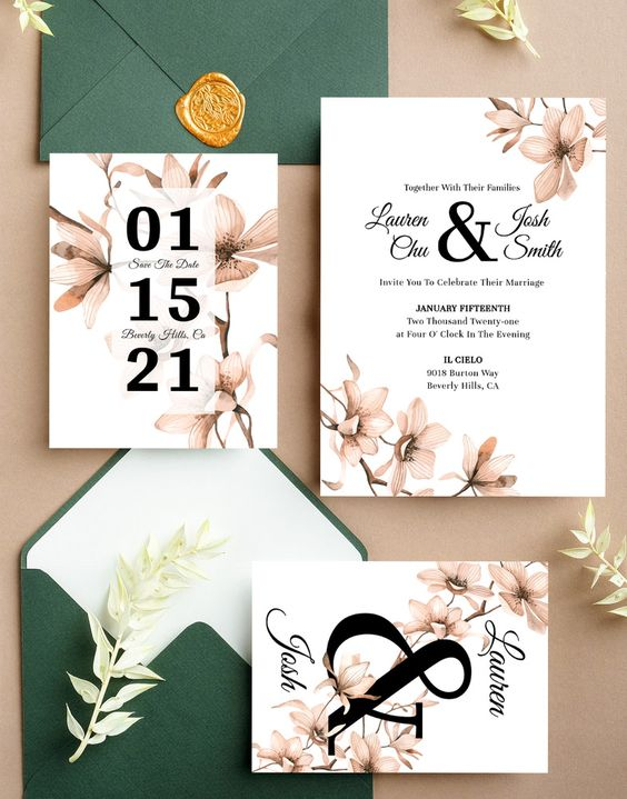 a beautiful and delicate floral wedding invitation suite with dusty pink flower prints and black letters plus green envelopes