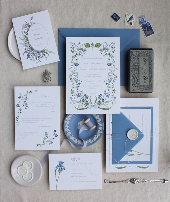 a blue and white floral wedding stationery suite with pretty patterns and frames, with blooms and wreaths is a stylish idea for a spring wedding