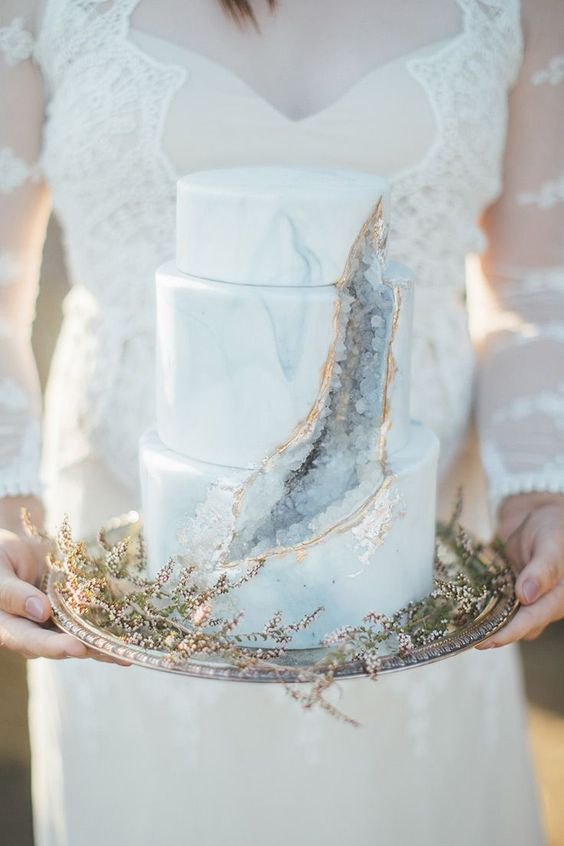 a blue marble wedding cake with geodes and gold leaf is a refined and chic idea to rock