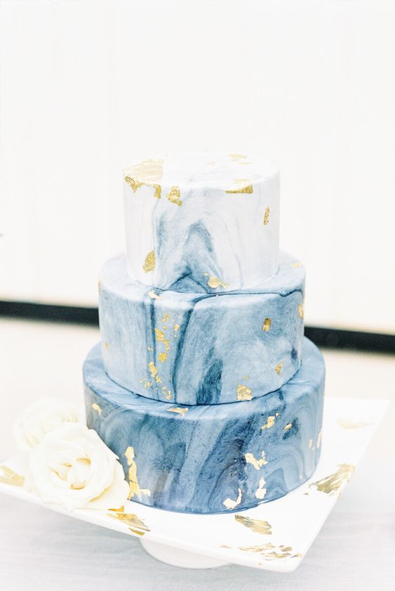 a blue marble wedding cake with gold leaf is a very chic and stylish idea for a modern wedding