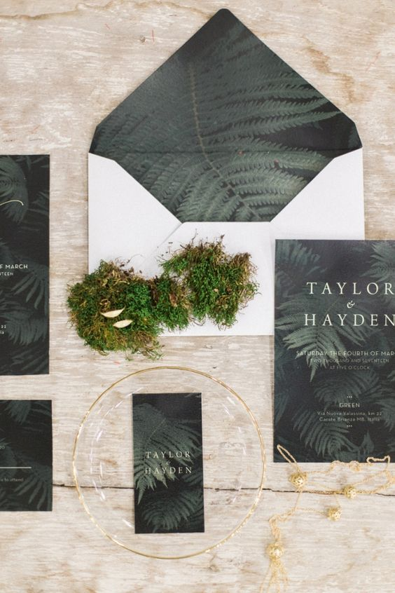 a bold forest-themed wedding stationery suite with dark fern printing on the lining and invites is amazing
