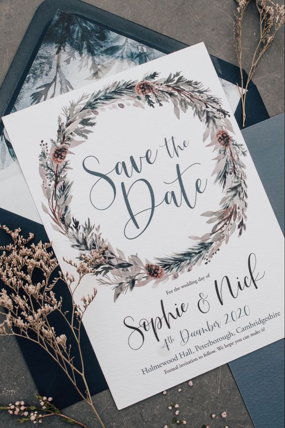 a bold winter botanical wedding invitation suite with a lovely wreath and a black envelope with chic lining for a winter wedding