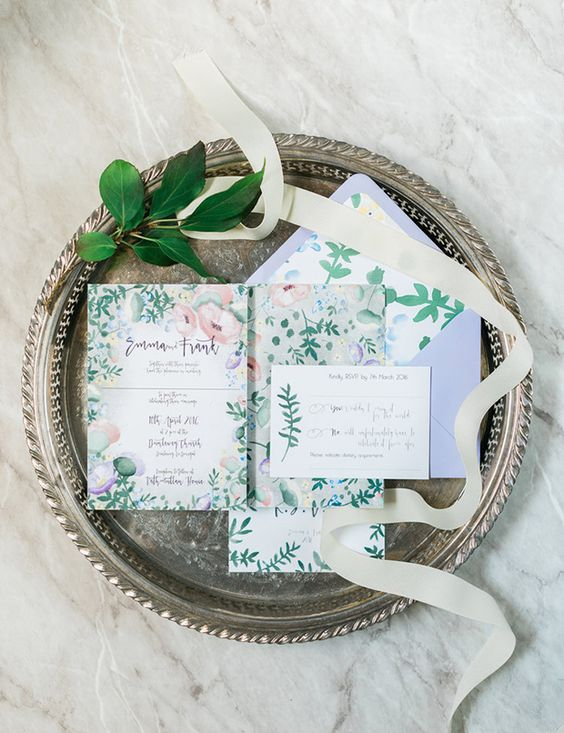 a botanical wedding invitation suite done in muted colors is a lovely idea for a spring wedding or a summer one in muted shades