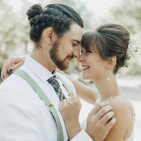 a braided man bun with leek hair on top is a bold and unique idea to bring a touch of boho to the look