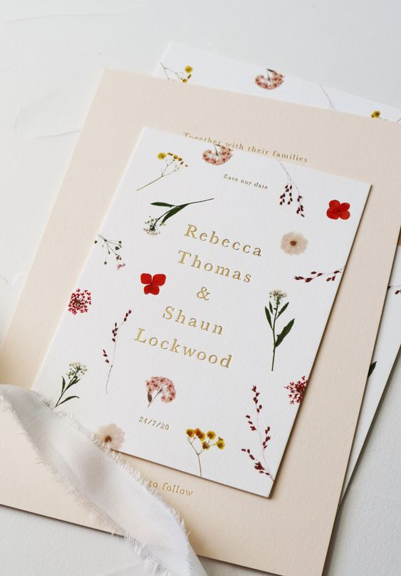 a bright botanical wedding invitation with colorful flower prints is a lovely idea for a modern summer or jsut wildflower wedding