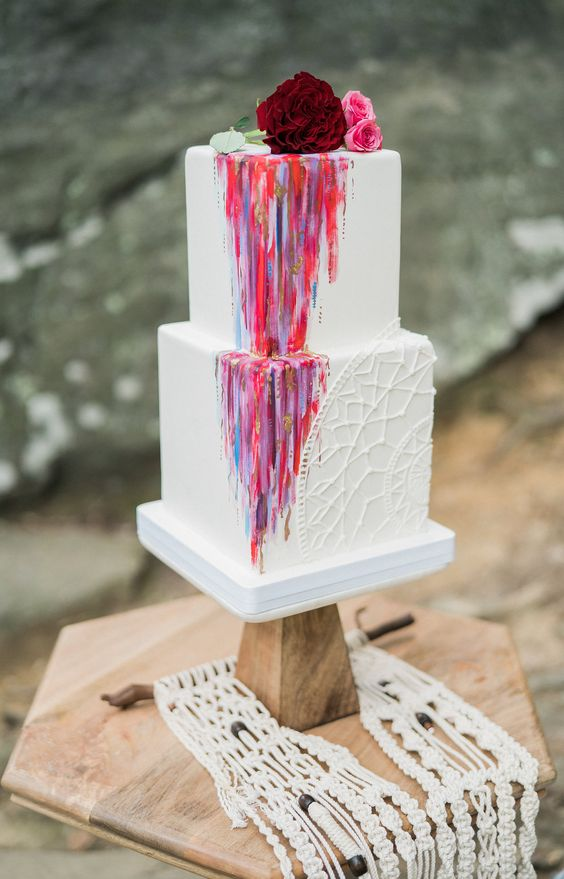 a bright square wedding cake with sugar macrame, bold watercolor, fresh blooms on top for a summer boho fest