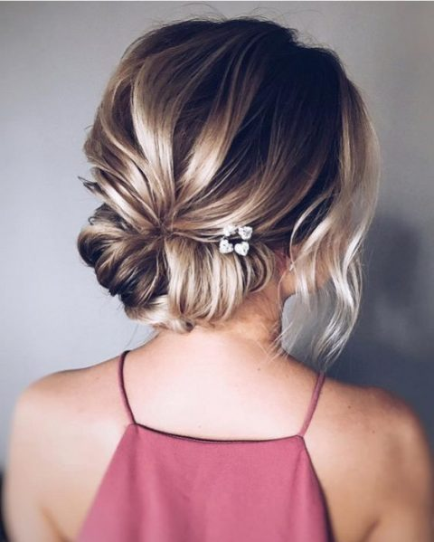 a casual updo with a twisted low bun and a bump plus some locks down