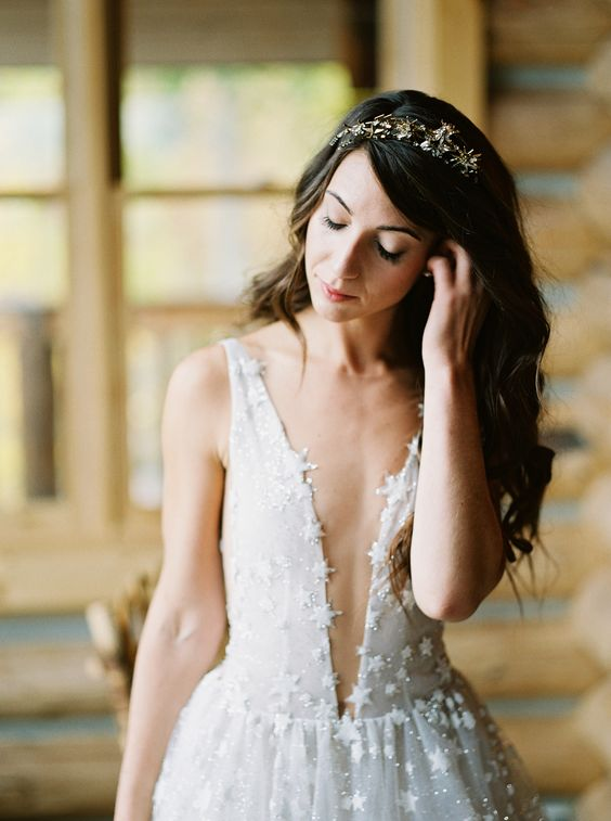 a celestial bride wearing an A-line star wedding dress with a plunging neckline and a star headpiece