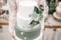 a chic wedding cake with a white, marble and green tier, gold leaf, greenery and a pale succulent is very trendy