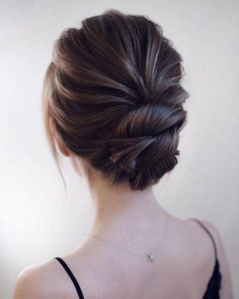 a chic wedding updo with a dimensional bump and twists will keep you picture-perfect during the whole day