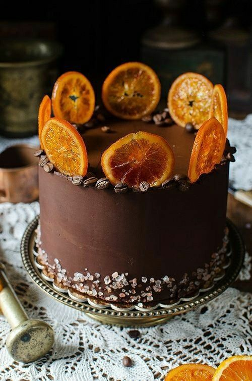 a chocolate and coffee wedding cake with sea salt and candied citrus slices is an alternative to a usual wedding cake