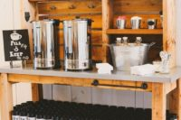 a coffee station with personalized travel tumblers that will double as wedding favors