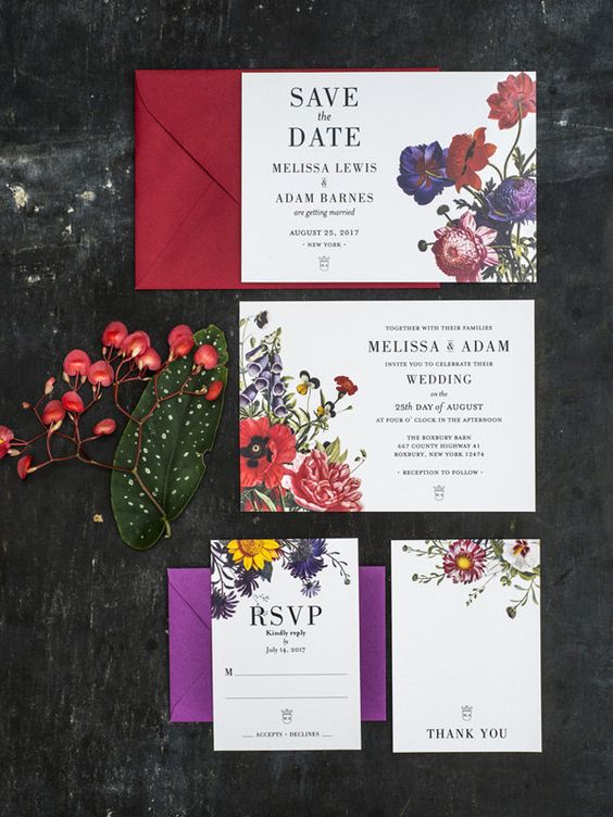 a colorful botanical wedding stationery suite with bold flower prints and a purple and red envelope is a stylish idea