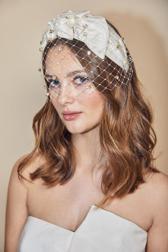 a crystal birdcage veil paired with a large bow is a lovely idea for a bride who loves glam and vintage