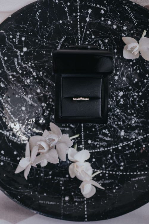 a dark wedding ring dish with a sky map is an amazing idea for a celestial or galaxy wedding