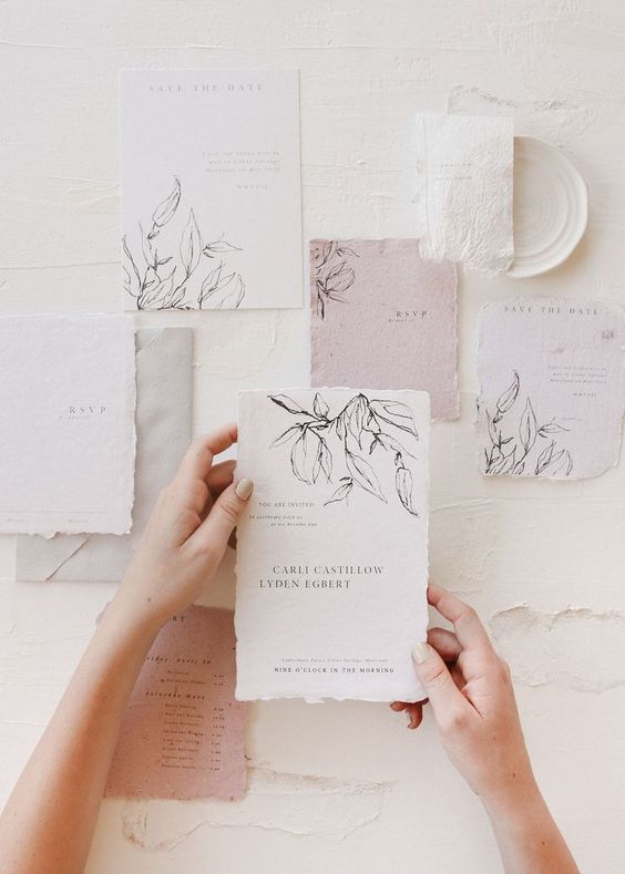 a delicate white, pastl pink botanical wedding invitation suite with a raw edge is a chic idea for a subtle spring or summer wedding