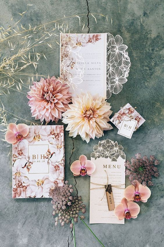 a gorgeous pastel-colored floral invitation suite with laser cut and printing is amazing for any spring or summer wedding