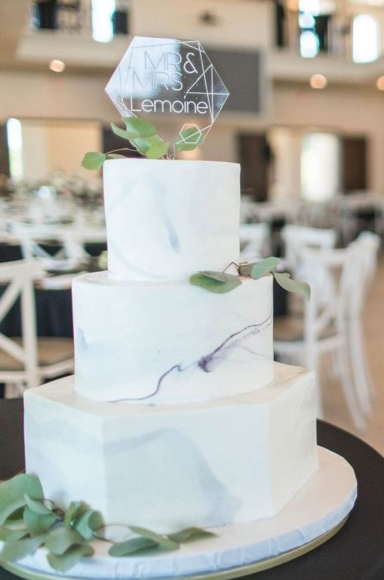 a grey and lilac marble wedding cake with fresh foliage and an acrylic hexagon topper is an amazing idea