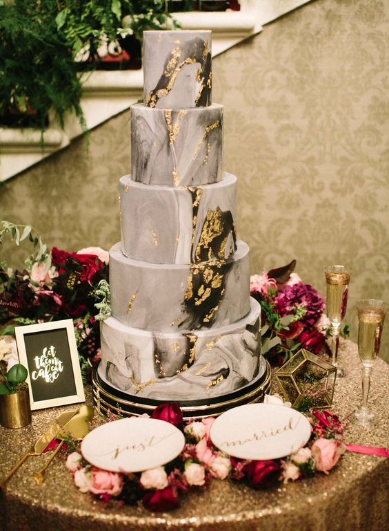 a grey marble wedding cake with gold leaf is a stylish and statement idea for a modern refined wedding