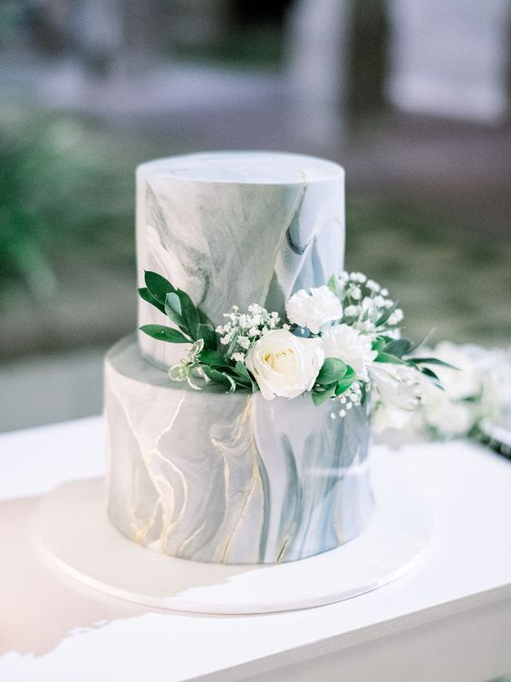 a grey marble wedding cake with greenery and white blooms is a gorgeous idea with a timeless feel