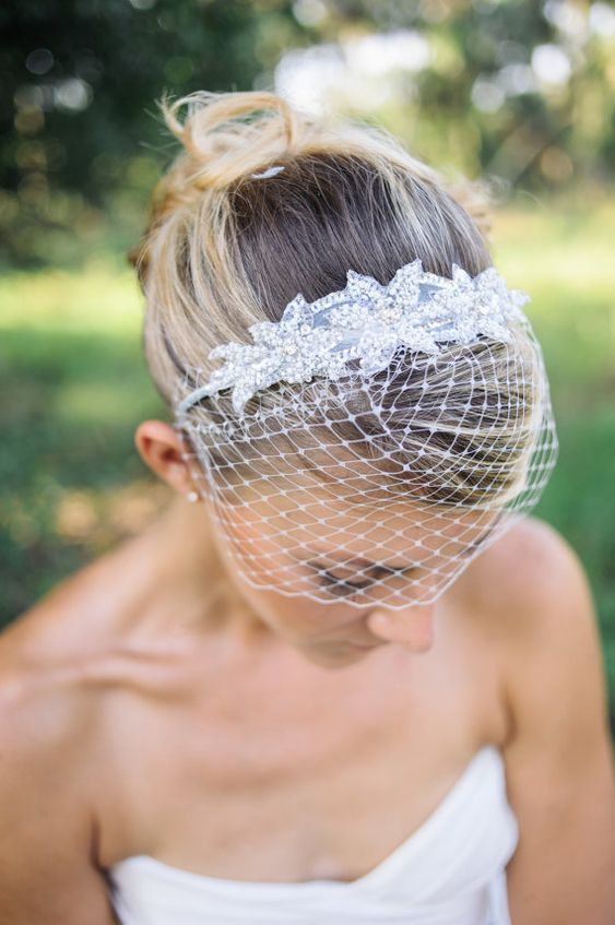 a headband with embellished lace appliques and a birdcage veil is a lovely and comfy to wear piece