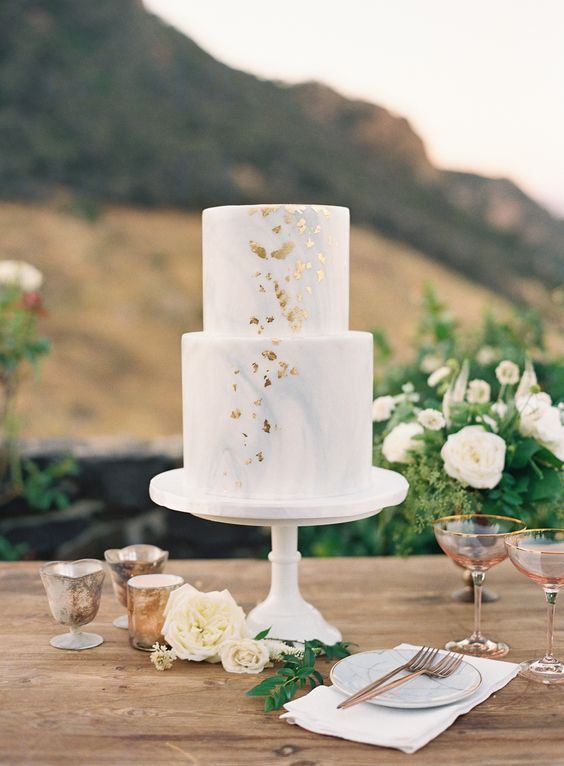 a light blue marble wedding cake with gold leaf is a lovely idea for a coastal or beach wedding