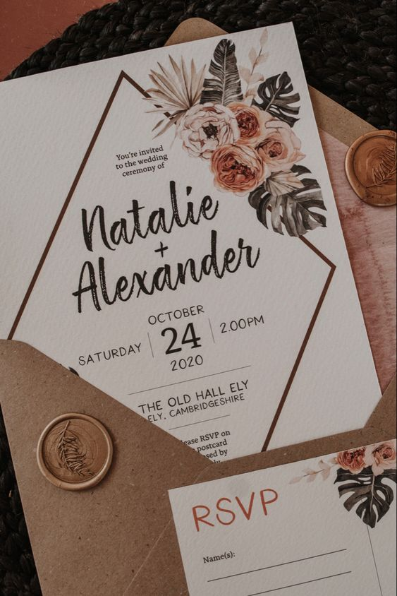a lovely botanical print wedding stationery in neutrals and pastels, with seals and a kraft paper envelope