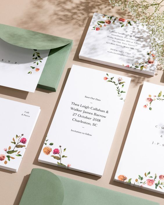 a lovely botanical wedding stationery suite with bold flower prints and elegant green envelopes will fit a summer wedding