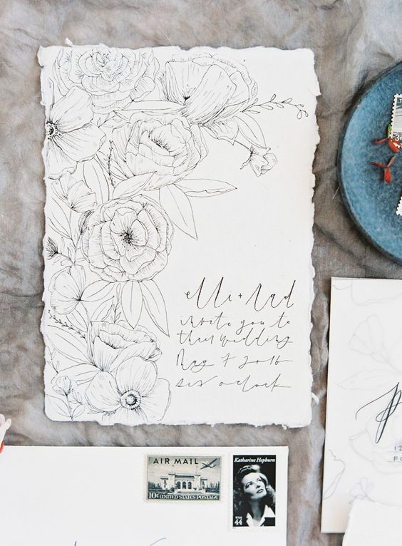 a lovely floral wedding invitation in black and white, with subtle printing is a very delicate and stylish idea to rock