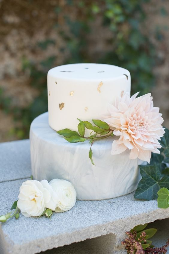 a lovely wedding cake with a white and a grey marble tier, with gold leaf and a large blush bloom is amazing for a spring wedding