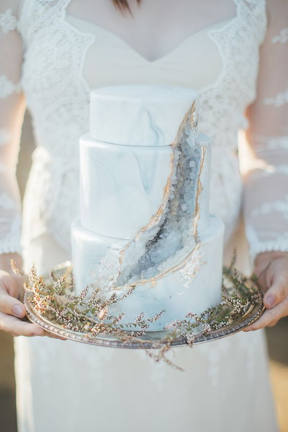 a marble and geode wedding cake with gold edge is a trendy and statement idea for a modern wedding