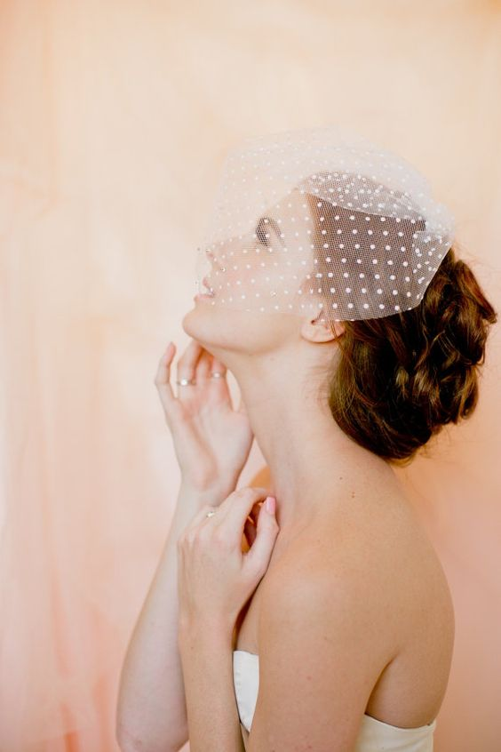 a mini pleated polka dot wedding veil is a pretty and girlish idea for a modern and playful bride