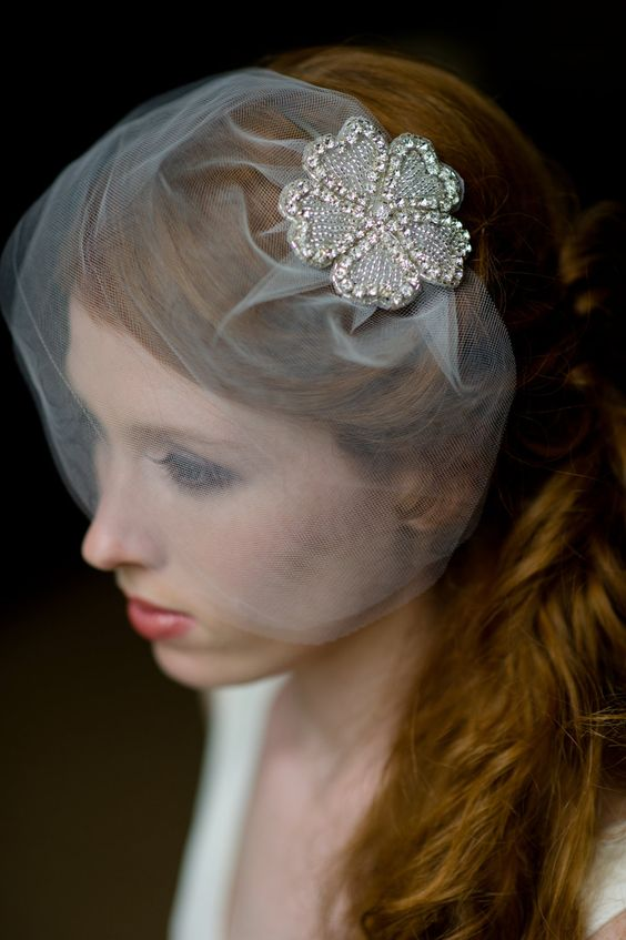 a mini veil with an embellished floral for an accent is a pretty and refined idea for a romantic and chic bride