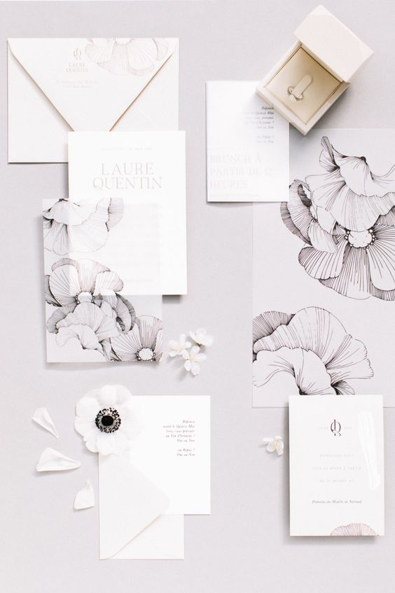 a modern black and white floral print wedding invitaiton suite is a super chic and fresh idea to use such prints