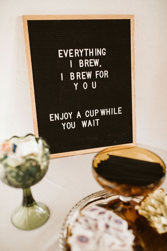 a modern black and white wedding sign with simple letters will highlight your wedding coffee bar