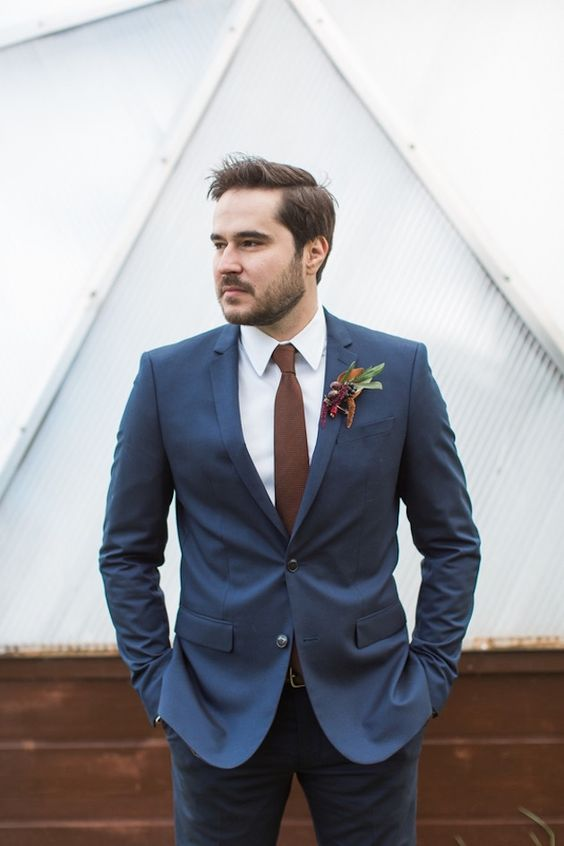 a navy blazer, a white button down, a burgundy tie, navy jeans for a chic yet relaxed groom's look