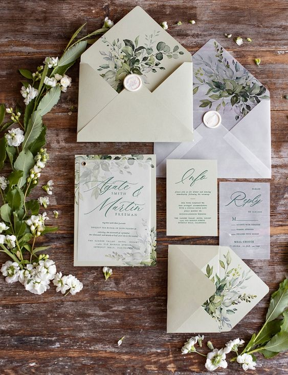 a neutral botanical wedding invitation suite with botanical prints and green calligraphy is a lovely solution for spring