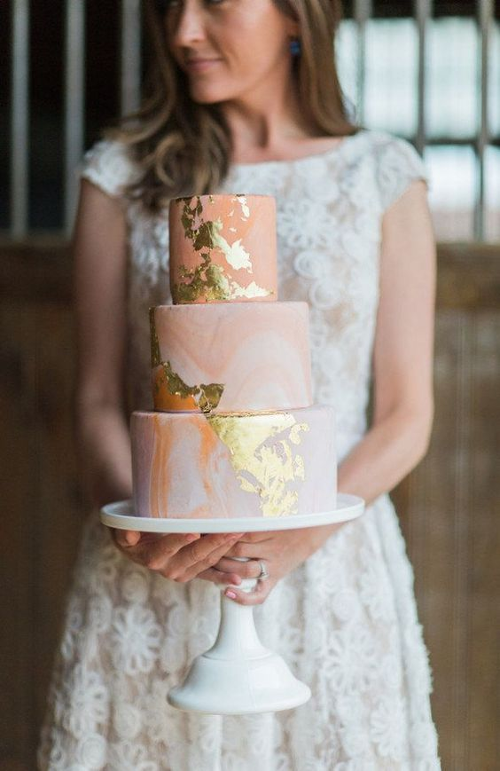 a pink marble wedding cake with gold leaf is a pretty glam idea for a romantic wedding done in pastels