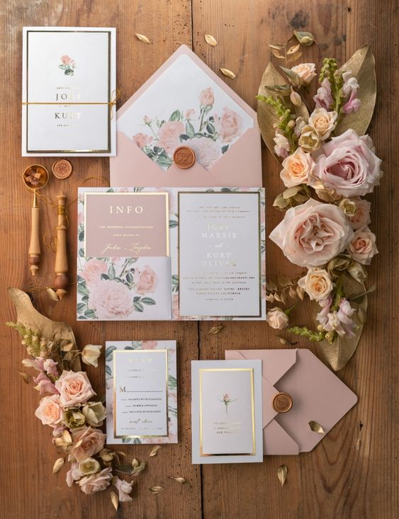 a pink, white and gold floral wedding invitation suite with gold frames and lovely blooms is a beautiful idea for a glam wedding